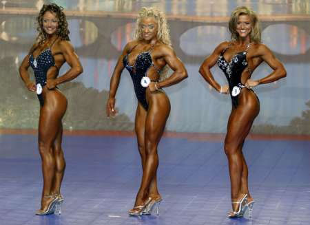 Physique contestants are not allowed to wear shoes and must compete